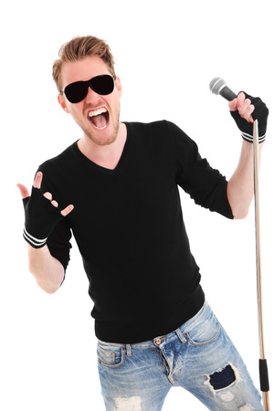 Cool rocker in sunglasses wearing a black shirt holding a mic stand with a microphone  White background  photo