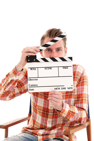 Man holding a film slate sitting down in a directors chair  White background