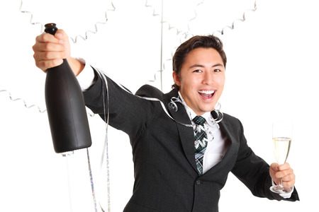 Happy party guy with champagne bottle wearing a suit and tie  White background  photo