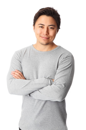 good looking man: Young good looking man standing wearing a grey shirt  White background