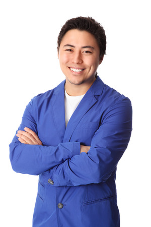 good looking man: Young good looking man standing wearing a blue jacket   Stock Photo