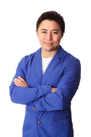 Young good looking man standing wearing a blue jacket   Stock Photo