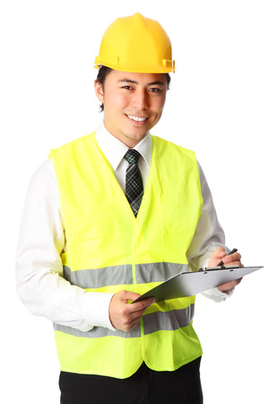 happy worker: Attractive young construction worker, wearing a white shirt and tie, with a hardhat