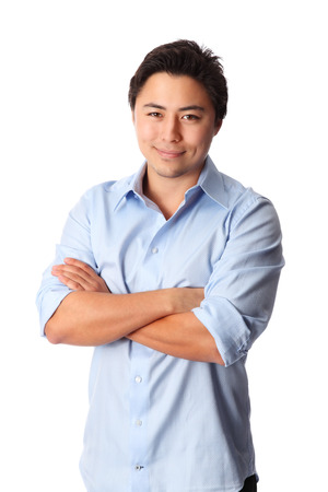 good looking man: Young good looking man standing wearing a blue shirt  White background  Stock Photo