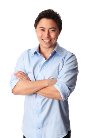 laid back: Young good looking man standing wearing a blue shirt  White background  Stock Photo