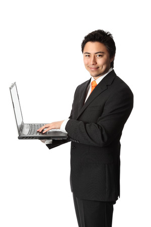lap top: Good looking businessman with a lap top computer, wearing a suit and tie