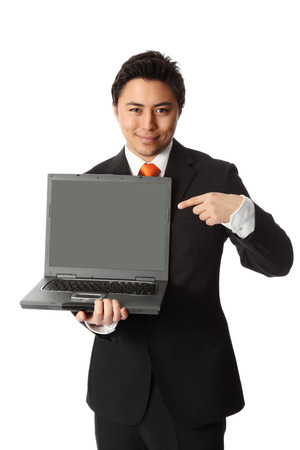 Good looking businessman with a lap top computer, wearing a suit and tie  Stock Photo