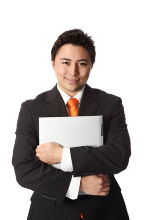lap top: Good looking businessman with a lap top computer, wearing a suit and tie Stock Photo