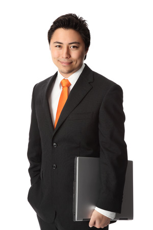Good looking businessman with a lap top computer, wearing a suit and tie  photo