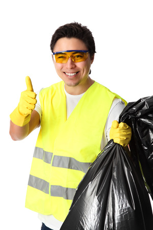 Young standing wearing a reflective vest, gloves and safety glasses  Holding a black garbage bag  White background