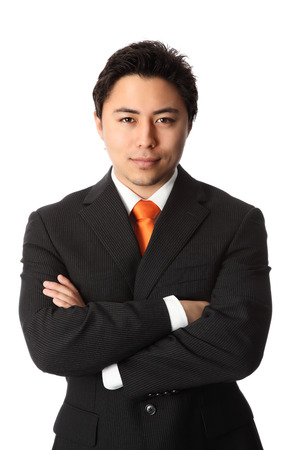 Young attractive businessman wearing a suit and orange tie  White background