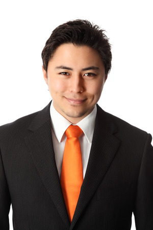 Young attractive businessman wearing a suit and orange tie  White background  photo