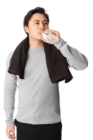 Attractive young man wearing a grey shirt with a towel around his neck  White background  photo