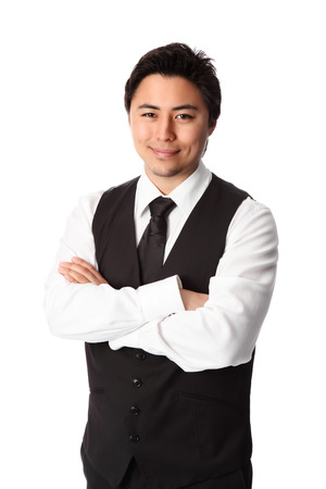 Young attractive waiter wearing a white shirt and black vest  White background