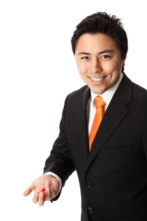 taking a risk: Attractive businessman in a suit and tie, holding red dices, taking a risk  White background  Stock Photo