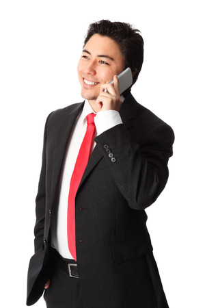Young attractive businessman working on the phone, wearing a suit and tie  White background