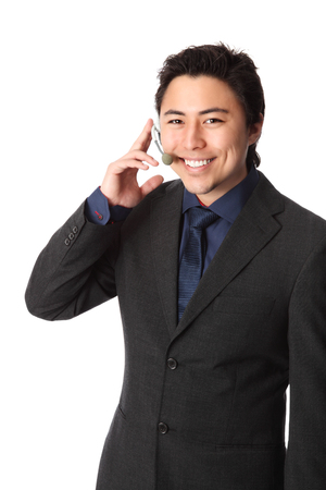 Young and attractive business wearing a suit and tie  Talking on a headset  White background  photo