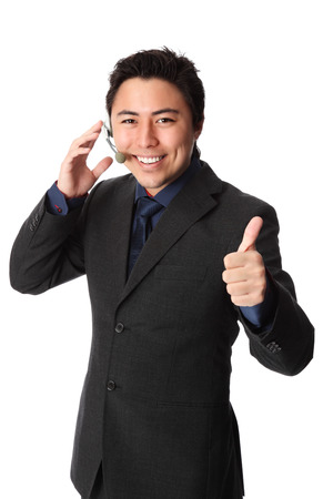 call center office: Young and attractive business wearing a suit and tie  Talking on a headset  White background
