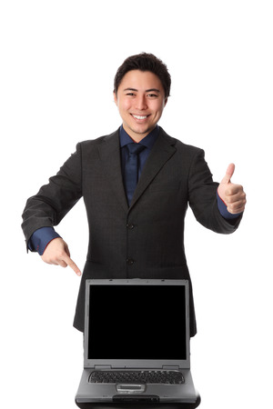 Attractive businesman showing on a laptop computer  Wearing a suit and blue tie   photo