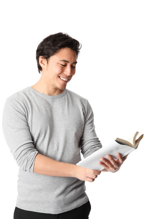good looking man: Young good looking man standing wearing a grey shirt, holding a blank book  White background