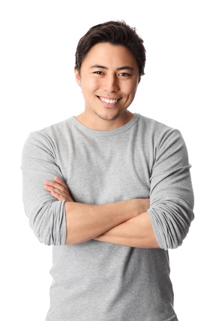 Young good looking man standing wearing a grey shirt  White background  photo