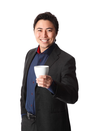 Attractive businessman on a coffee break  Wearing a suit and blue shirt  White background  photo