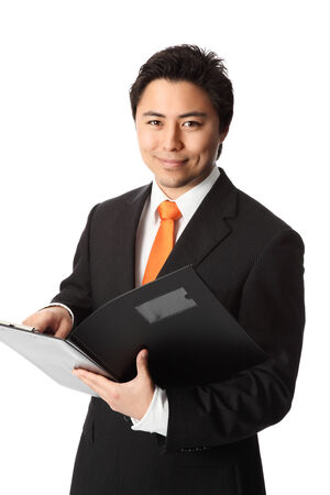Attractive businessman wearing an orange tie and black suit holding a folder  White background  Stock Photo