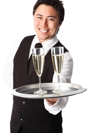 Attractive waiter serving 2 glasses of champagne photo