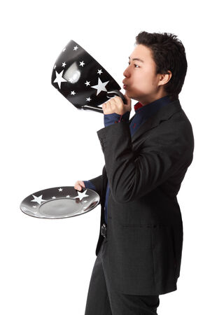 przewymiarowany: Good looking businessman holding an oversized coffee cup, wearing a suit and tie  White background