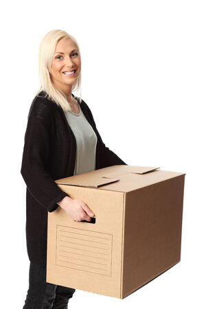 Attractive blonde woman with a cardboard box  Wearing casual clothing  White background  photo