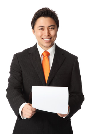 Young attractive businessman wearing a black suit and orange tie  Holding a clipboard  White background  photo