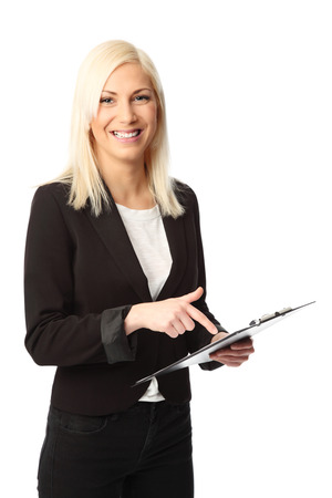 Attractive businesswoman wearing a suit and shirt, holding a clipboard