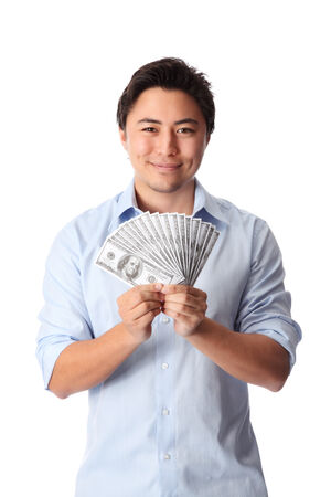 Attractive man wearing a shirt, holding a fan of dollar bills in front of him  White background  photo