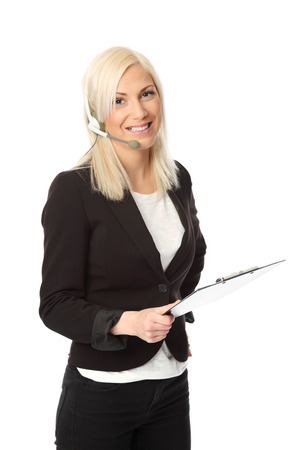 Attractive business woman wearing a black jacket with a white shirt  Wearing a headset and holding a clipboard  White background