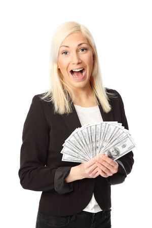 Attractive business woman, wearing a suit and shirt  Holding a big fan of dollar bills  White background  photo