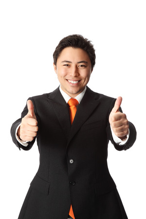 Attractive businessman in a suit and tie, doing thumbs up  White background  photo