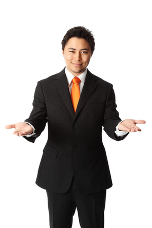 Attractive businessman in a suit and tie, showing  White background  写真素材
