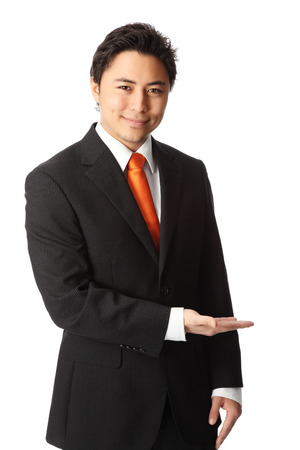 Attractive businessman in a suit and tie, showing  White background  photo