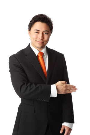 Attractive businessman showing and pointing, wearing a suit and tie  White background  photo