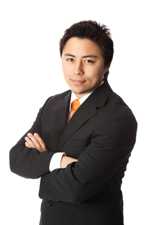 well made: Young attractive businessman wearing a suit and orange tie. White background.