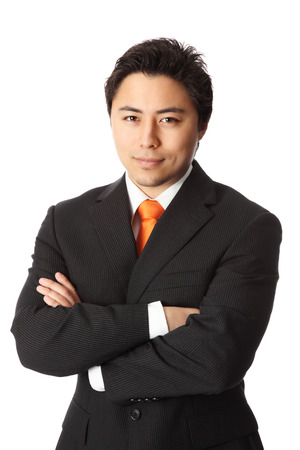 orange man: Young attractive businessman wearing a suit and orange tie. White background.