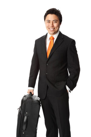 Attractive businessman wearing a suit and tie, with a bag. White background. photo