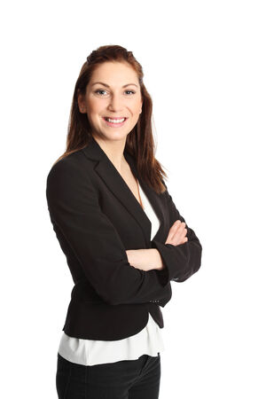 A young attractive businesswoman in her 20s, standing isolated on a white background wearing a black suit and white shirt. White background.