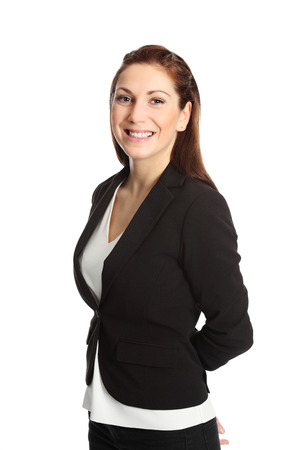 A young attractive businesswoman in her 20s, standing isolated on a white background wearing a black suit and white shirt. White background. photo