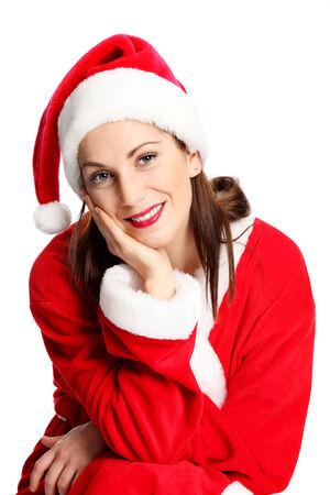 se�ora: Un joven linda y atractiva se�ora de Santa Claus sentado, vestido con un traje rojo y un sombrero. Fondo blanco. Foto de archivo