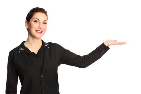 selling service smile: An attractive woman wearing a black shirt with red lipstick standing in front of a white background, gesturing.
