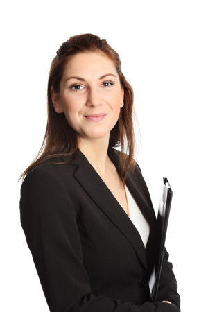 A young professional businesswoman wearing a suit and white shirt, holding a clipboard. White background. Stock Photo
