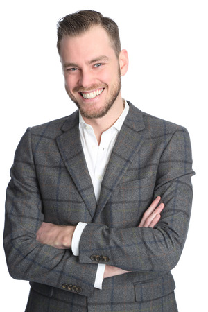 Young and attractive businessman standing against a white background wearing a grey jacket and white shirt. White background. photo