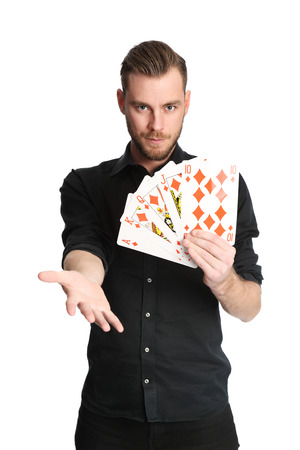 his shirt sleeves: Young and attractive man wearing a black shirt with his sleeves rolled up, holding a fan of a royal flush in diamonds on big sized cards.