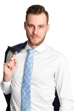 Young and attractive businessman standing against a white background wearing a blue jacket and white shirt. White background. photo